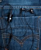 Headset in back pocket Royalty Free Stock Photo