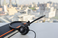 Headset on the black notebook Stock Image