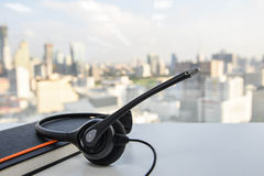 Headset and black notebook Stock Photo