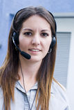 Headset Communications Woman. Call center pretty  woman answering phone Royalty Free Stock Image
