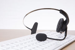 Headset with computer keyboard. On desk at call centre Stock Photos