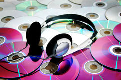 Headset and disks. A headset on a pile of disks royalty free stock photo