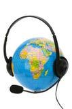 Headset on globe Stock Photo