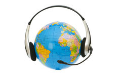 Headset on globe isolated Stock Photo