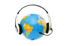 Headset on globe isolated Stock Images