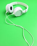 Headset on green background Stock Image