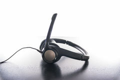 Headset Headphones Padded Ergonomic Black Plastic Modern Bright Work Desk. Headset Headphones Padded Ergonomic Black Plastic Modern Bright Work Royalty Free Stock Photo