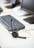 Headset And Keyboard On Desk Stock Photos