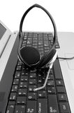 Headset on laptop Stock Image
