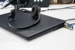 Headset on laptop computer royalty free stock photo