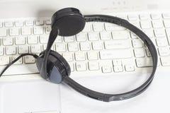 Headset on laptop computer keyboard Royalty Free Stock Photo