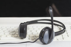Headset with laptop computer keyboard Stock Image