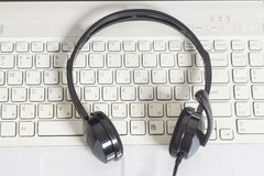 Headset with laptop computer keyboard Stock Photo