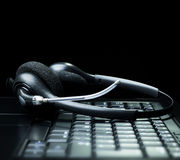 Headset on a laptop computer keyboard Stock Images