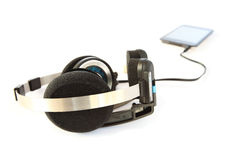 Headset and mp3 player. Isolated on white royalty free stock photo