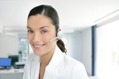 Headset phone business woman dress in white Stock Photography