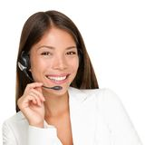 Headset woman. Headset. Customer service operator woman with headset smiling looking at camera. Beautiful mixed race Asian Caucasian call center woman isolated Stock Photos
