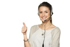 Headset woman call center operator. Smiling gesturing thumb up, against white background Stock Image