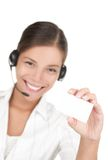 Headset woman holding business card Royalty Free Stock Image