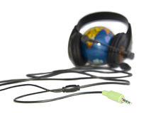 Headset on world globe isolated Royalty Free Stock Images