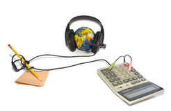 Headset on world globe with pencil, note and calcu Royalty Free Stock Photography