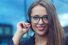 Headset young businesswoman representative communication customer support. Young woman representative talking in a phone microphone for customer support Stock Photos