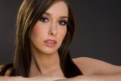 Melancholy Woman in Headshot Grey Background Stock Images