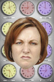 Headshot of angry businesswoman with different time zone clocks in background Royalty Free Stock Image