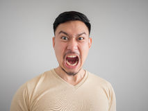 Headshot of angry and mad face. Headshot of angry and mad face of Asian man with beard and mustache Stock Image