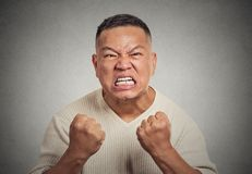 Headshot angry man with open mouth fist up in air aggressive screaming Royalty Free Stock Photo