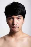 Headshot of Asian man face with no makeup Stock Images