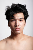 Headshot of Asian man face with no makeup Stock Photo