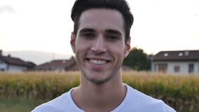 Headshot of attractive young man smiling to camera