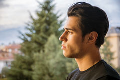 Headshot of attractive young, profile view Royalty Free Stock Images