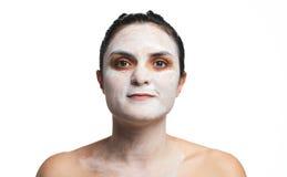 Headshot av kvinnan med kräm Arkivfoto