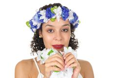 Headshot of beautiful black woman wearing flower headpiece. She`. S fancy for a carnival party. Concept of freshness Stock Photography