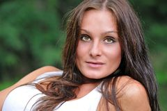 Headshot of beautiful brunette woman outdoors Royalty Free Stock Photos