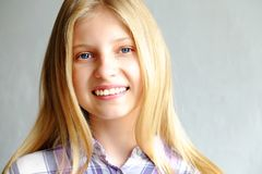 Young beautiful teenager model girl posing over white background showing emotional facial expressions. royalty free stock images