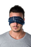 Headshot of blindfolded young man Royalty Free Stock Photo