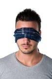 Headshot of blindfolded young man Royalty Free Stock Photo