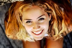 Headshot of blonde smiling woman Stock Image