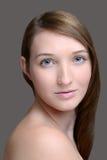 Headshot brunette on grey Stock Photos
