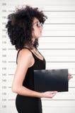 Headshot brunette model with afro like hair Royalty Free Stock Image