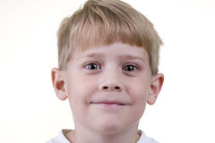 Headshot of a Child. A young child makes faces at the camera stock photography