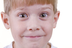 Headshot of a Child. A young child makes faces at the camera stock photo