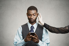 Headshot confused skeptical businessman reading bad news on smar Royalty Free Stock Photography