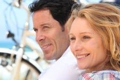 Headshot of couple with bikes Royalty Free Stock Image