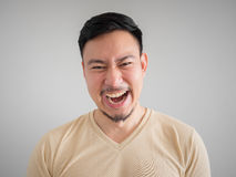 Headshot of crazy laughing Asian man. stock photo