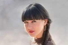 Headshot of a cute black haired women with braid Royalty Free Stock Image