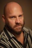 Headshot d'un homme chauve photographie stock libre de droits